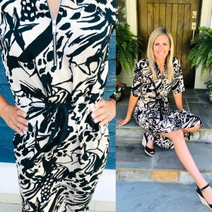 blonde women sitting on a porch with a topshop black and cream print tie-wasted mid-length dress.