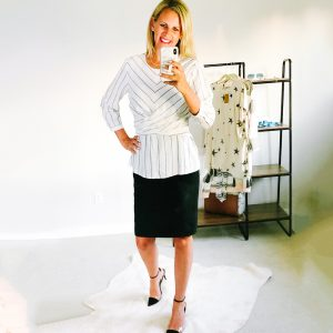 tall flat chested blonde wearing a black pencil skirt and a white blouse.