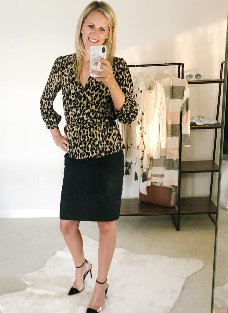 flat chested blonde woman in a leopard top and black skirt