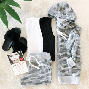flat lay of black fuzzy slippers, white tank top, blank tank top, gray Camo shorts, and gray Camo sweatshirt