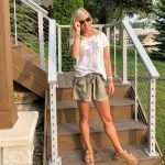blonde woman in a graphic t-shirts and olive green high waisted shorts by jack bb Dakota