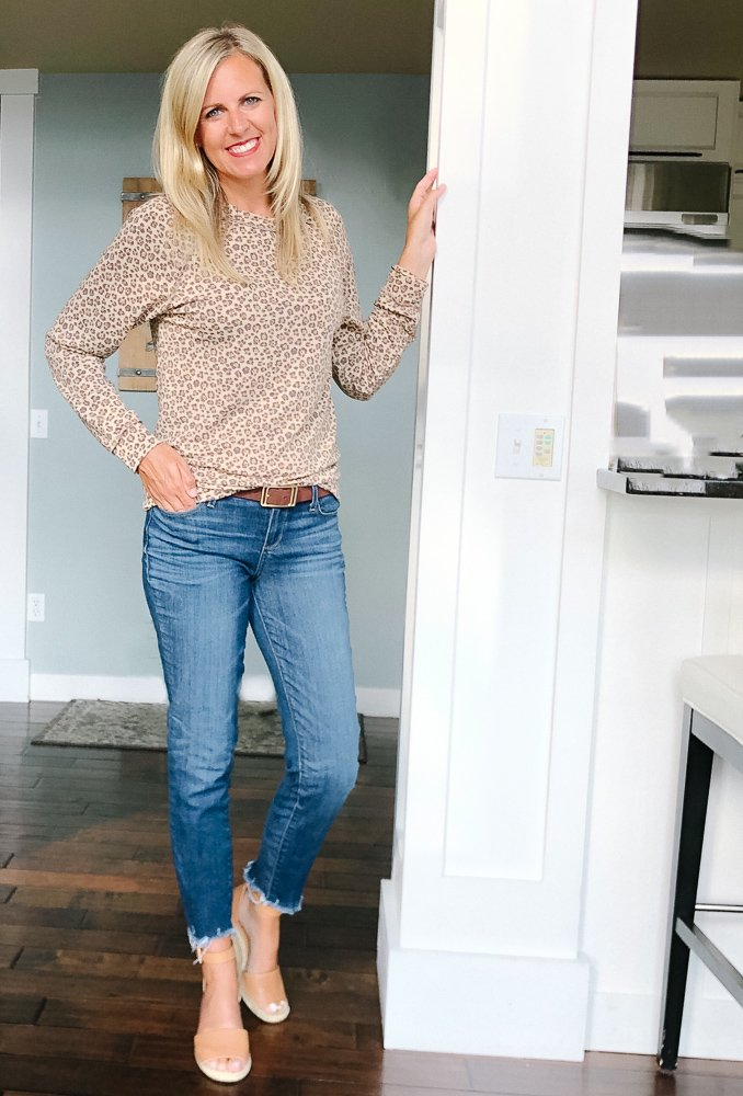 tall small chested blonde wearing a leopard print top and jeans