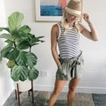 blonde woman in a black and white striped tank top with olive green high waisted shorts by jack bb Dakota