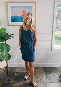 flat chested blonde woman wearing a blue Patagonia dress.