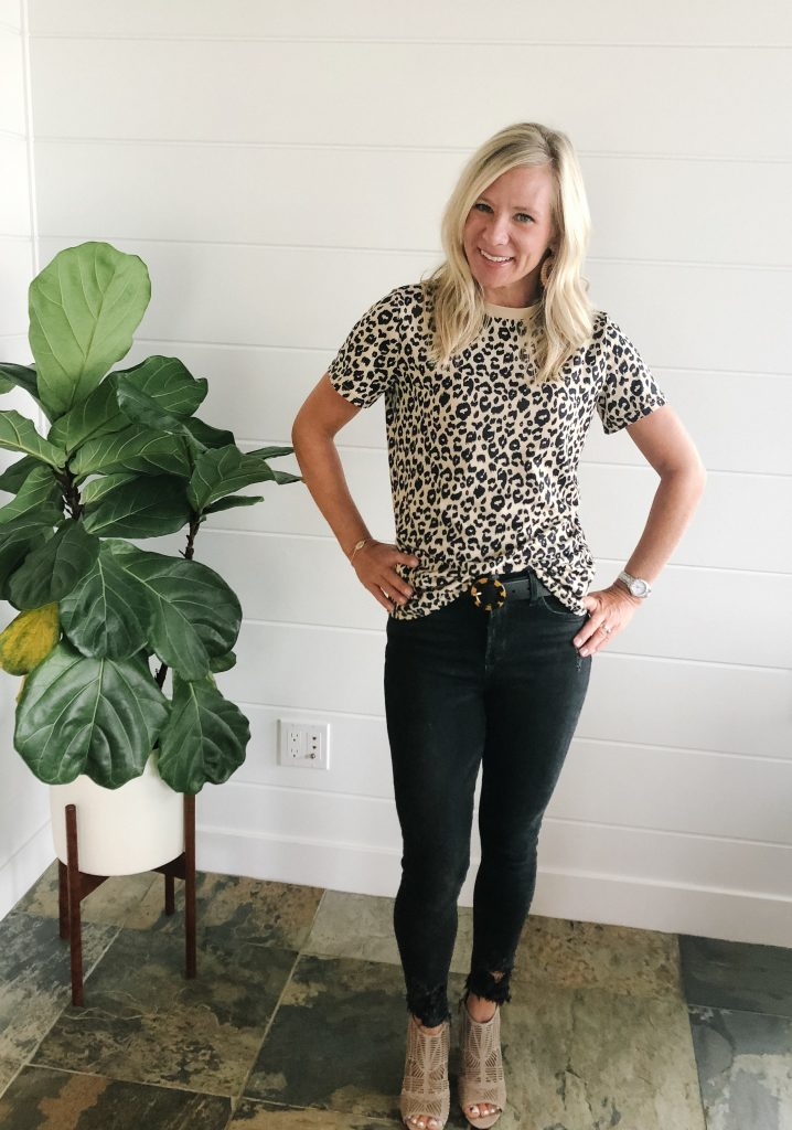 blonde woman wearing an Amazon leopard tee with black jeans