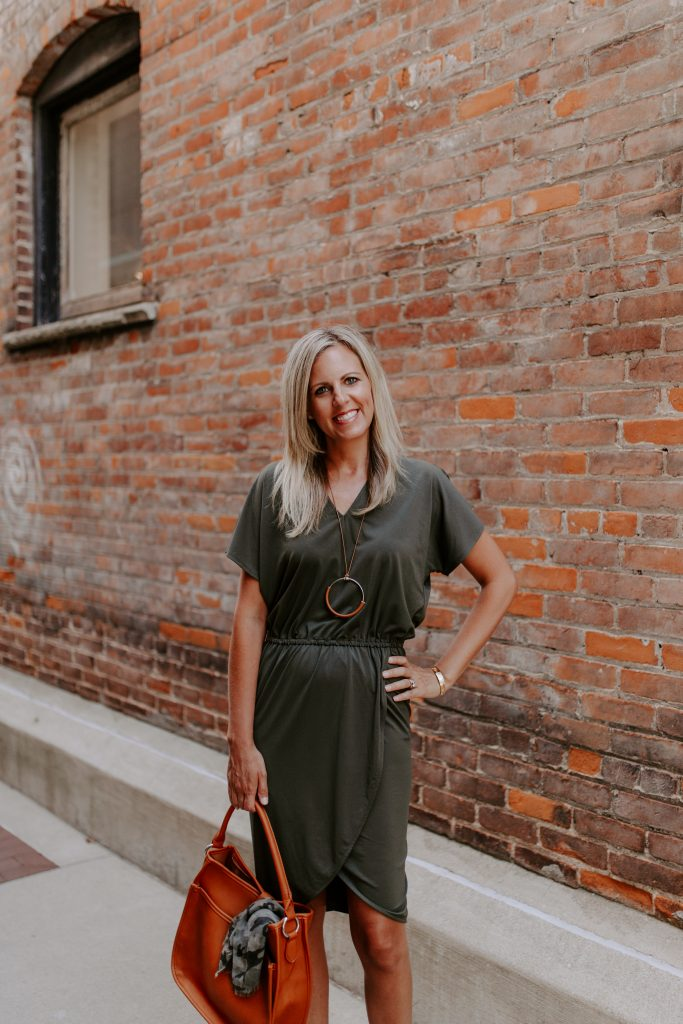blonde woman in an olive green dress