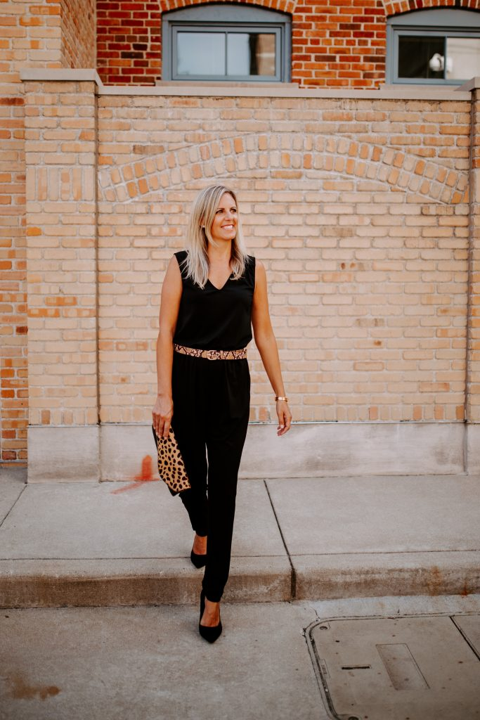 blonde woman in a black jumpsuit