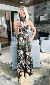flat chested blonde woman in a floral maxi dress