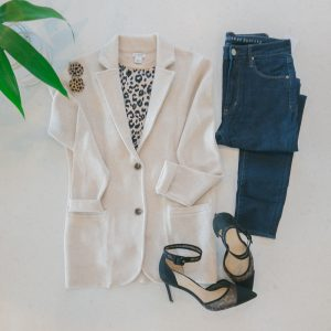 flat lay with JCREW cream sweater blazer and dark jean with leopard pumps.
