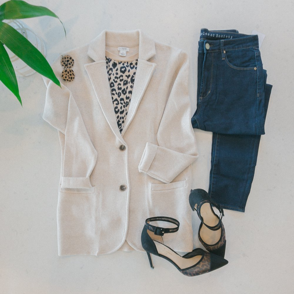 flat lay with JCREW cream sweater blazer and dark jean with leopard pumps.