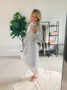 tall blonde wearing a grey UGG Robe