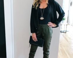 Tall Blonde wearing a silk coat with green joggers and camo pumps