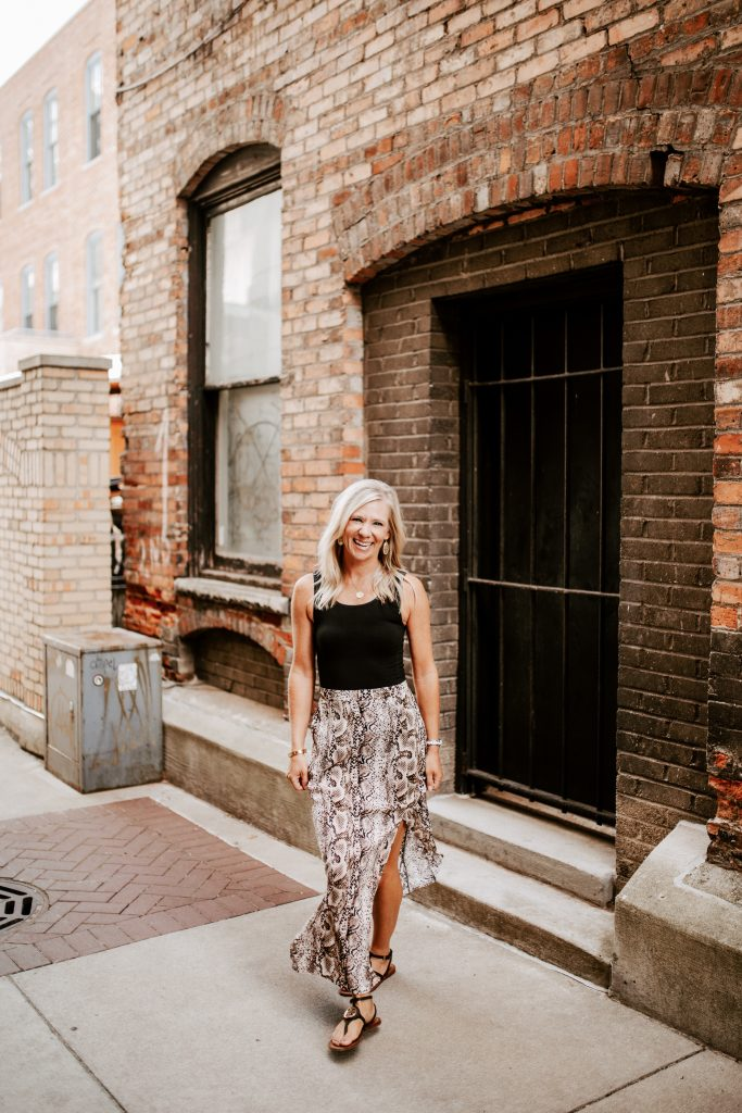 blonde, flat chested woman in a Target leopard print maxi skirt and black Commando bodysuit