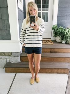 blonde woman in Madewell striped sweater and navy blue shorts