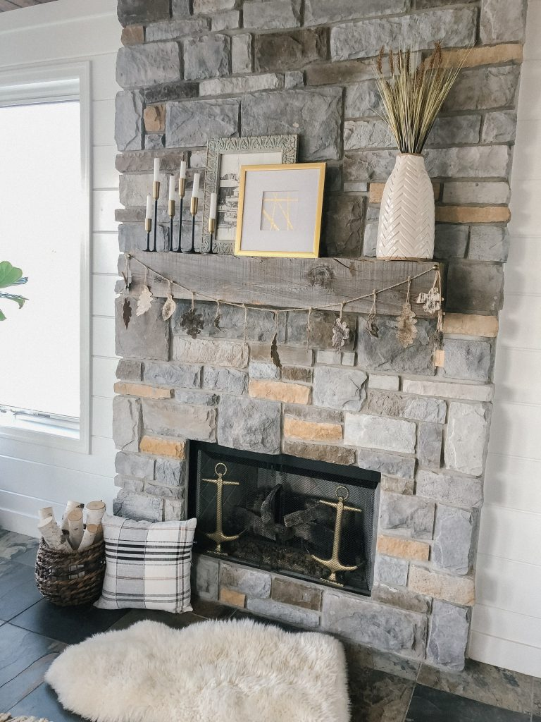 Fall mantel with wheatgrass and candlesticks