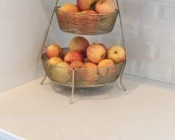 basket of apples in a kitchen