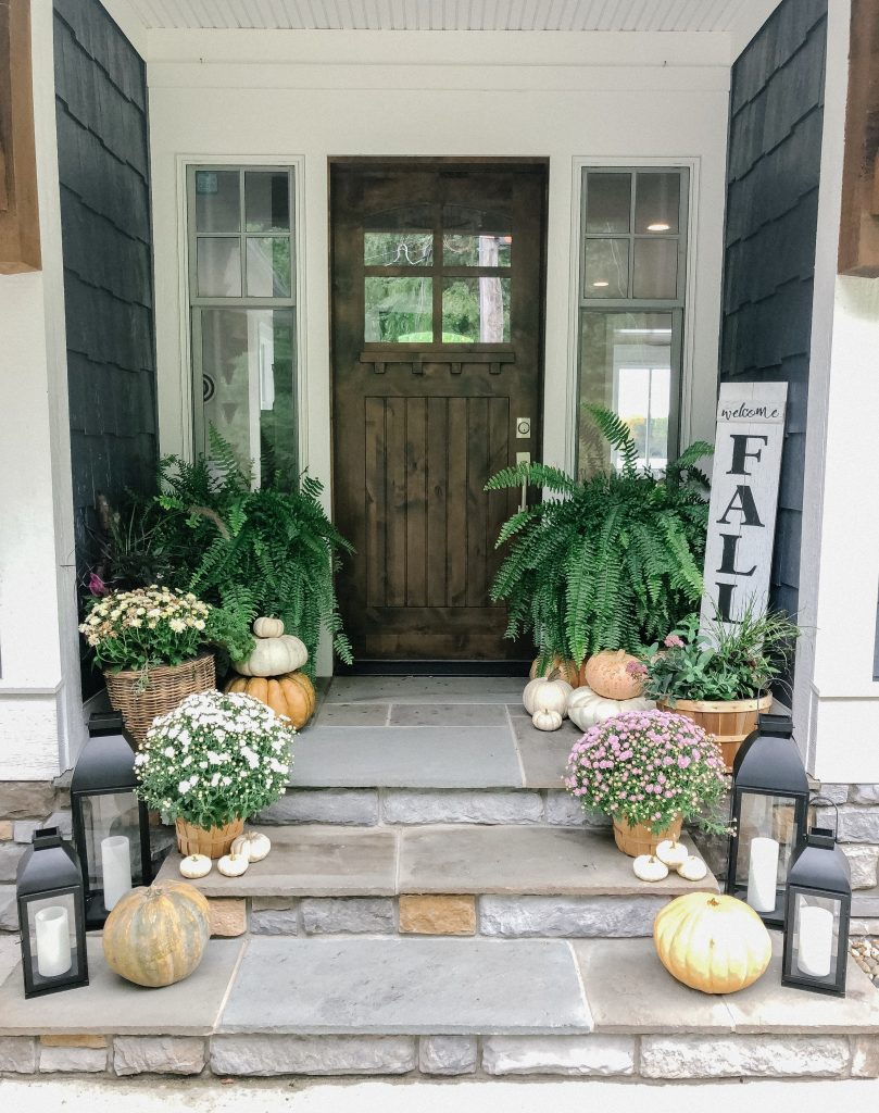 fall front porch with pumpkins and mums