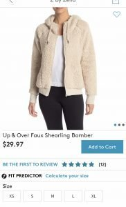 fuzzy, cream colored Zella bomber jacket