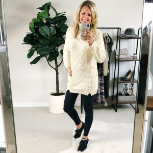 Tall blonde wearing amazon cream turtleneck sweater with navy leggins