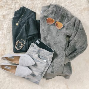 a flat lay with a grey cozy zella sweatshirt, camo jeans and sam edelman flats.