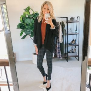 Tall blonde wearing plaid pants with a rust color top and boyfriend blazer and black heels.