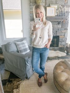 blonde woman in an Amazon fashion beige sweater and AG jeans