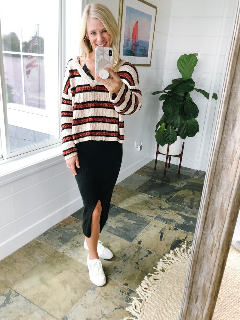 How to wear a midi skirt by The Barely B's, a lifestyle blog: image of woman standing inside her house wearing Free People Skyline Midi with a Target Wild Fable striped sweater, and Tretorn tournament net 2.0 sneakers