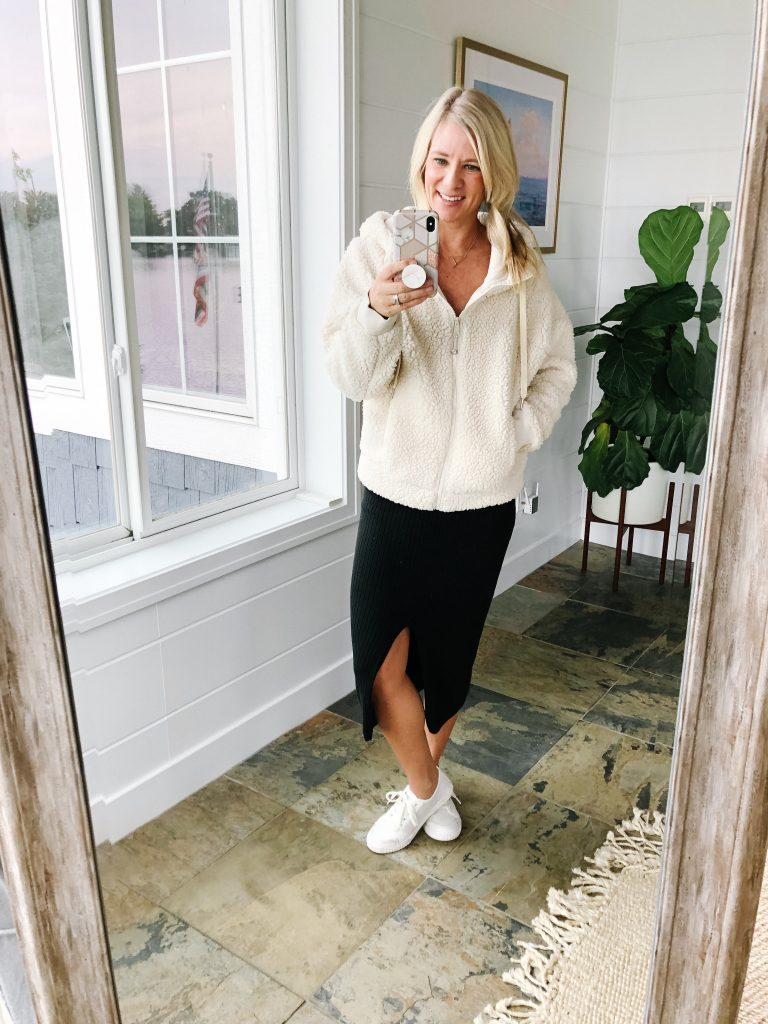 How to wear a midi skirt by The Barely B's, a lifestyle blog: image of woman standing inside her house wearing Free People Skyline Midi with a Zella sherpa jacket, and Tretorn tournament net 2.0 sneakers