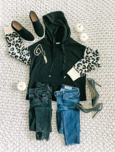 flatlay with sweatshirt and jeans