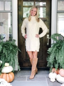 Fashion Lifestyle Blogger, Amy from the Barely B's, wearing a cream sweater dress from Amazon standing on her front porch