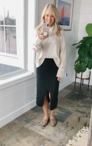 How to wear a midi skirt by The Barely B's, a lifestyle blog: image of woman standing inside her house wearing Free People Skyline Midi with a Caslon cream turtleneck sweater, and Steve Madden snakeskin feather studded loafers