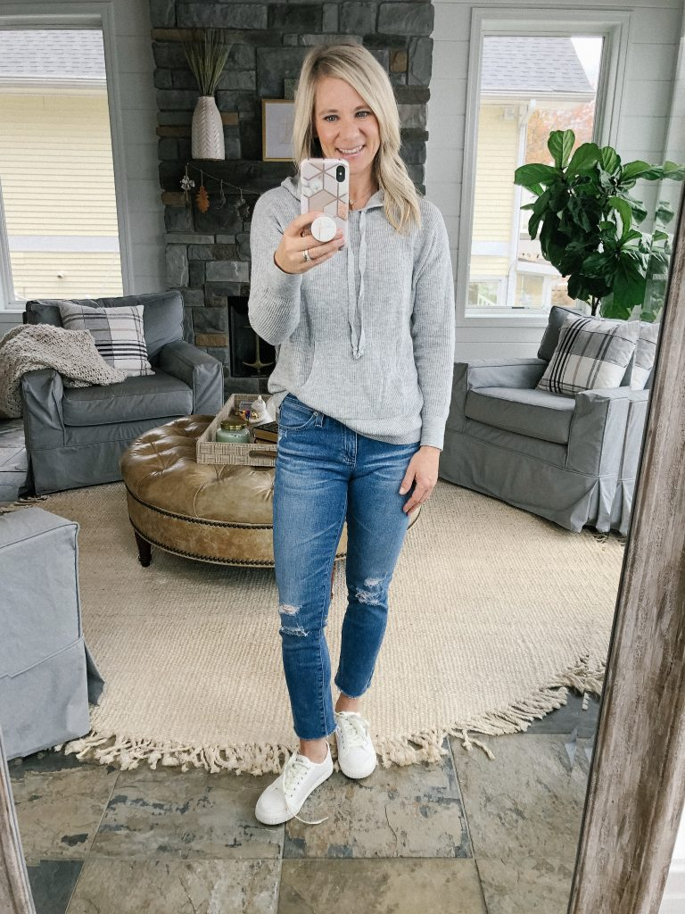 Lifestyle blogger, The Barely B's, wearing a Loft sweatshirt sweater with distressed AG jeans