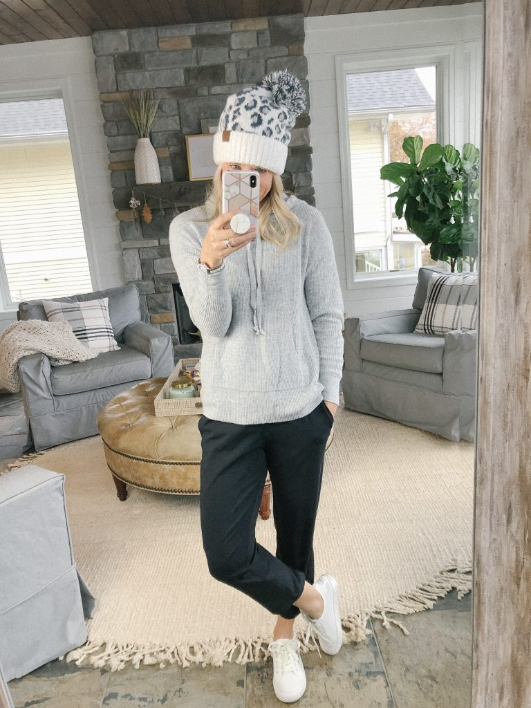 Lifestyle blogger, The Barely B's, wearing a Loft gray sweatshirt sweater, Lululemon black pants, and a leopard knit cap