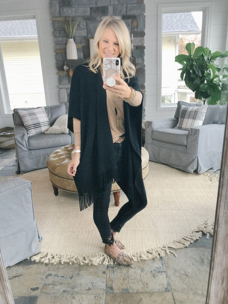 Lifestyle blogger, The Barely B's, wearing a tan Abercrombie sweater, Loft black fringe wrap, and black jeans