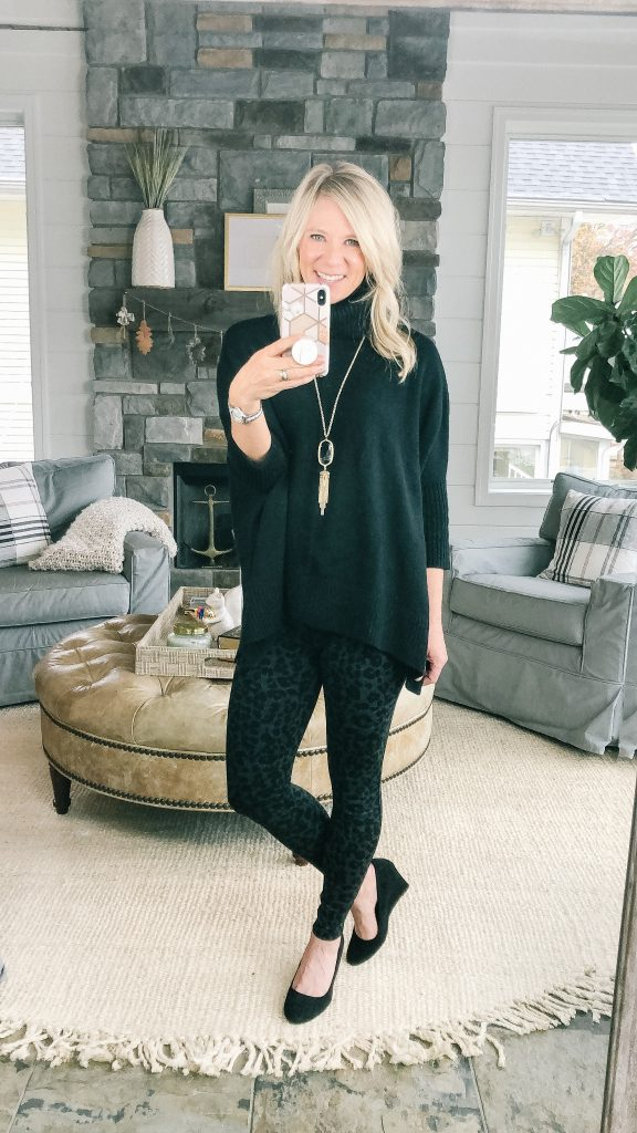 Lifestyle blogger, The Barely B's, wearing a Loft black poncho sweater and Loft leopard print leggings