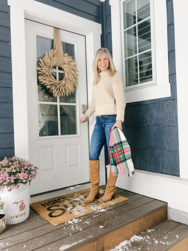 Lifestyle Blogger, The Barely B's, wearing a Free People cream sweater, jeans, and knee high brown boots