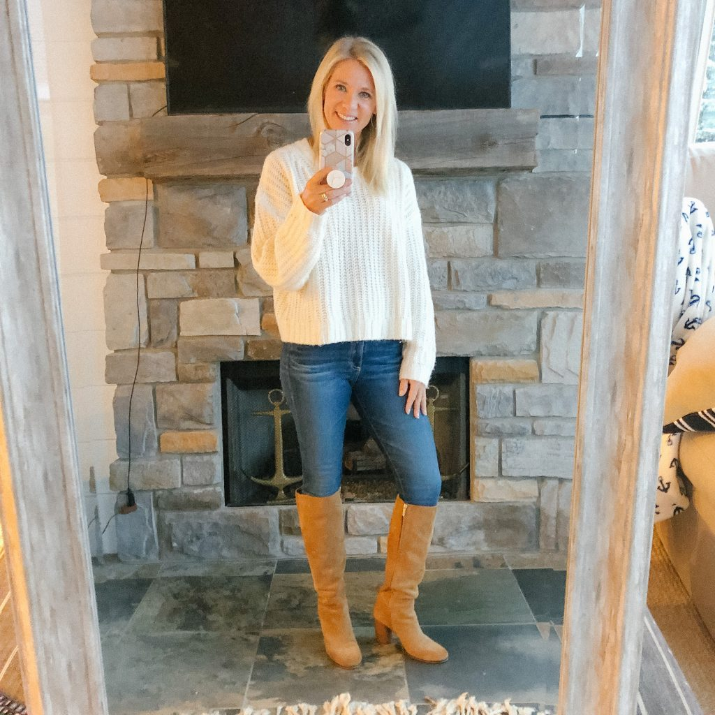 Lifestyle Blogger, The Barely B's, wearing an American Eagle cream sweater, blue jeans, and knee high brown boots