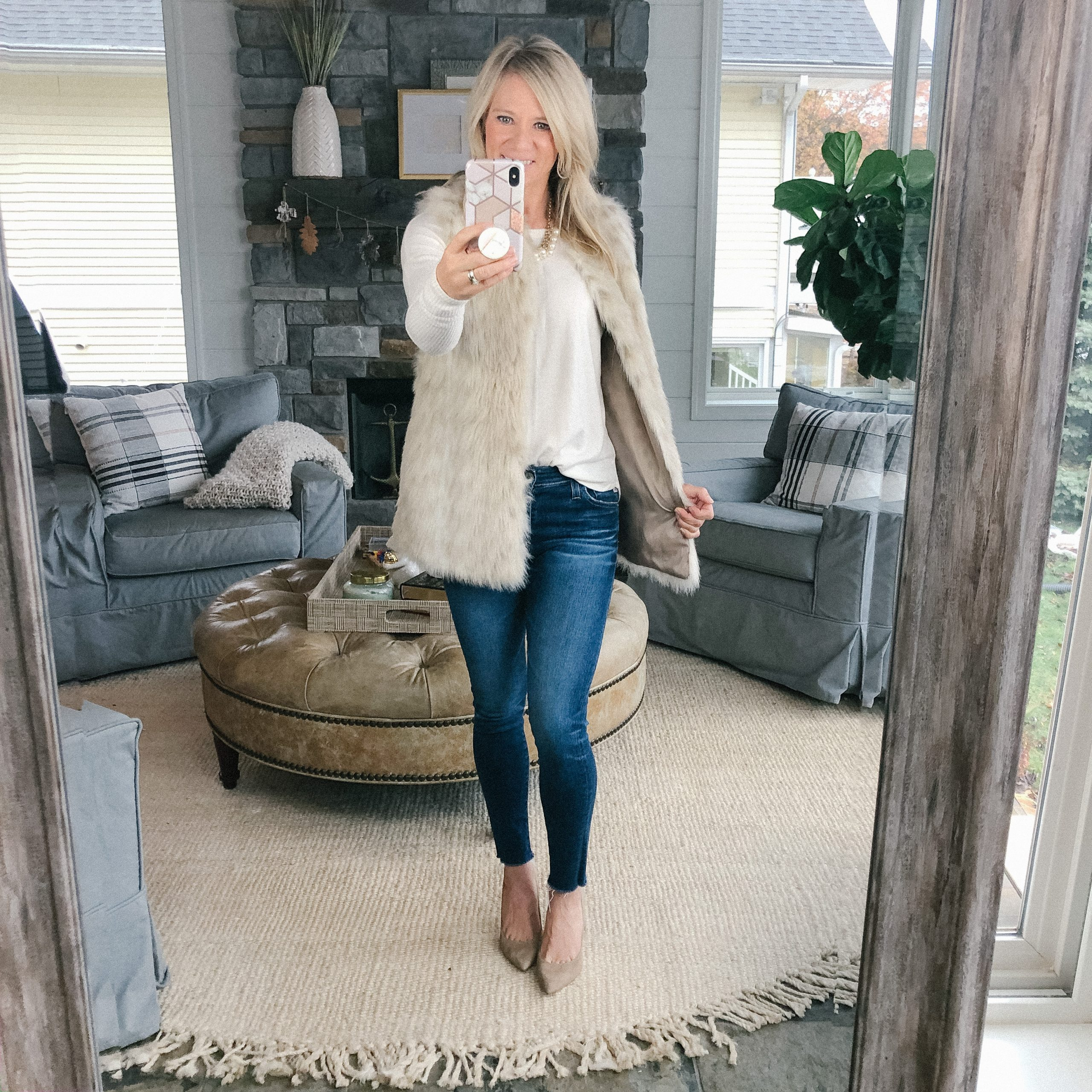 The Barely B's blogger wearing an Abercrombie cream sweater, fur vest, jeans, and tan heels
