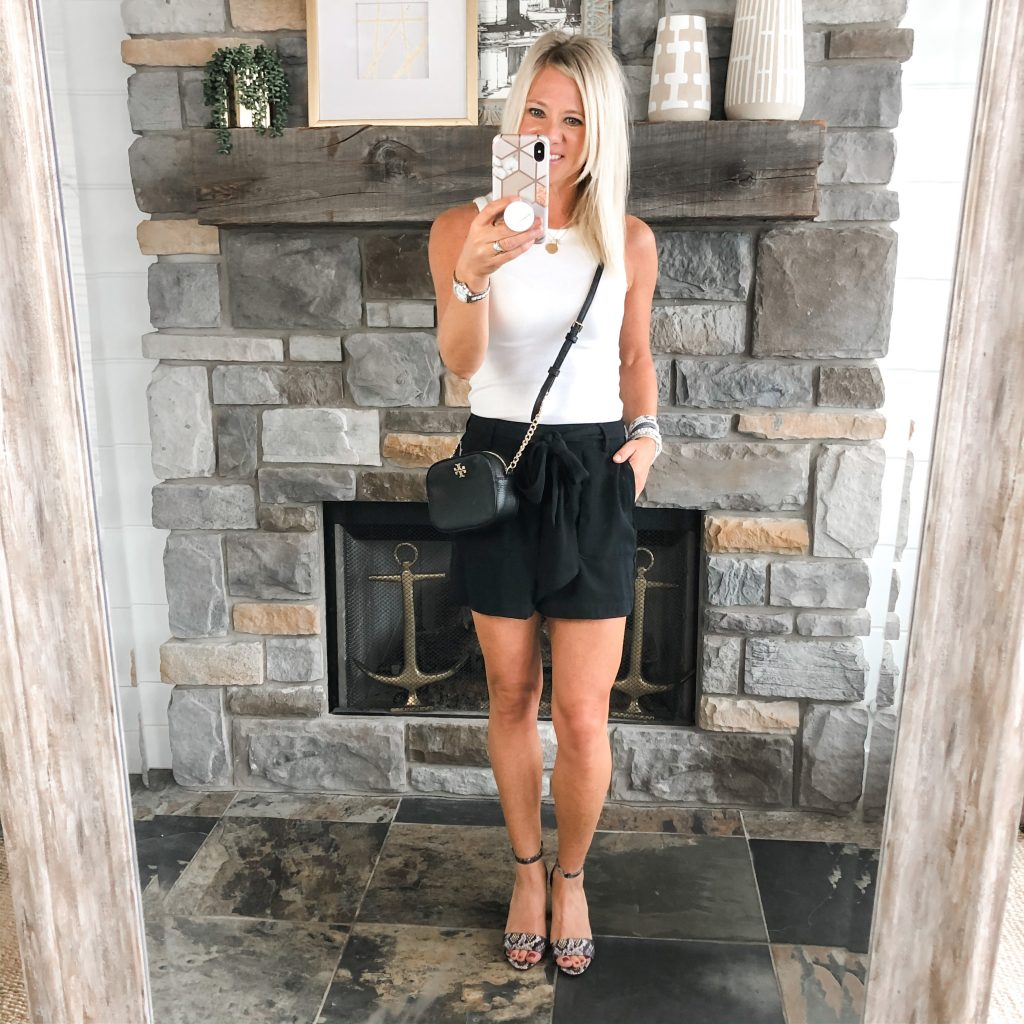 Lifestyle blogger, The Barely B's, in Target white tank and paperbag shorts with heels