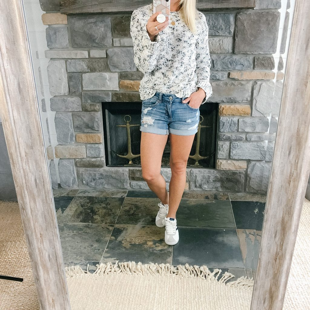 Lifestyle blogger, The Barely B's, in a Target sweater and jean shorts