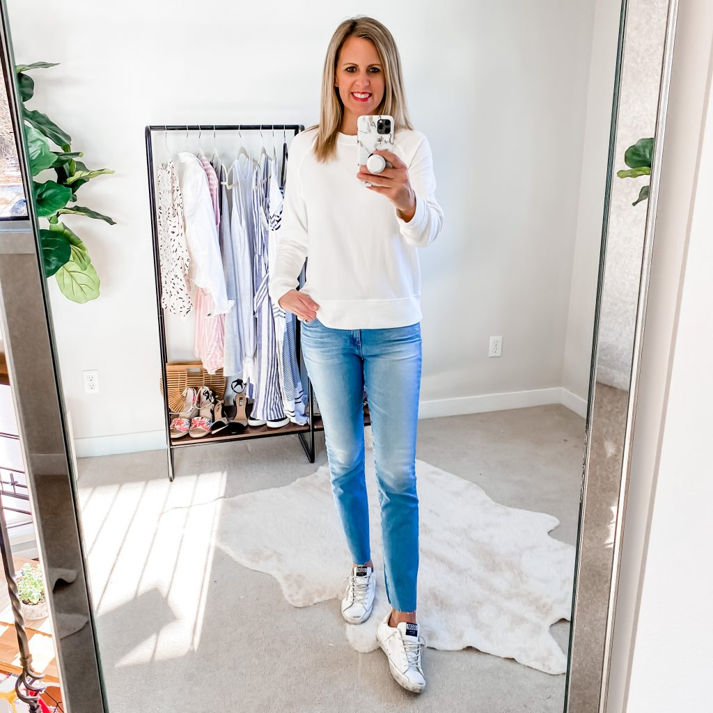 Lifestyle Blogger, The Barely B's, in a white Target sweatshirt and jeans