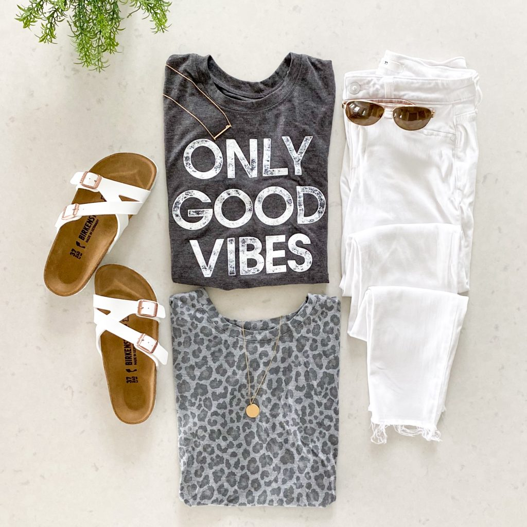 Flat Lay with Two Target Graphic Tee-Shirts, white Jeans, and white Birkenstocks